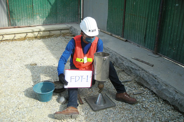 Field Density Test Repair Concrete Plate Front of DESP Project